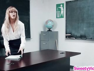 Horny woman and her lesbian student are making love in the classroom and using a strap- on
