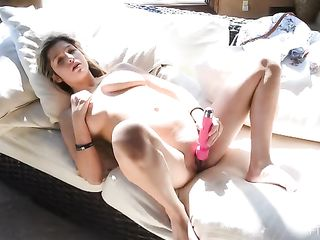 Young girl vibrator rubs her pussy