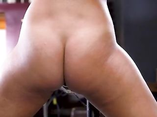 Beats a naked girl in the ass and fingering pussy vibrator