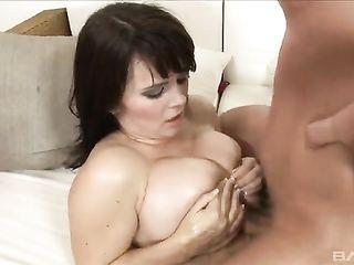 Busty bitch makes man cum on big boobs