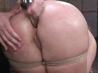 Hammering in the ass and whipping a bound girl