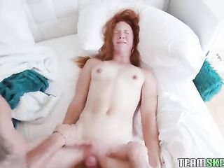 Red-haired curl rubs her pussy on a dick and sucks