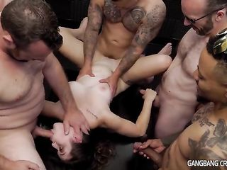 Several men actively fucking a pretty girl