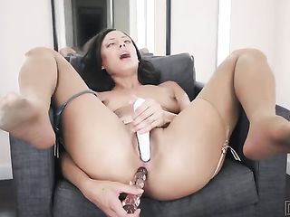 Woman drives dildo in the ass and massages the clitoris with a vibrator