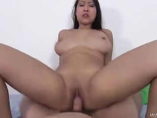 Young Thai girl rides a guy's dick