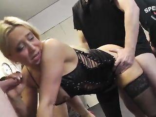 Slut in a corset sucked a crowd of men