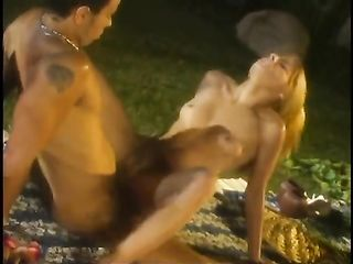 Orgy at night in the garden of an expensive mansion