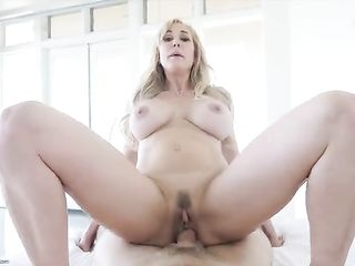 Busty madame rides cock of a young lover
