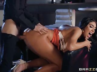 Tanned babe with silicone breasts is having sex in a bar
