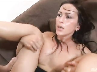 Kisses the hips of a dark-haired lady during sex