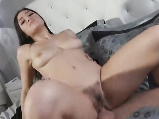 Beautiful brunette gets an orgasm in a pose from above