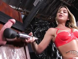 Blonde in red latex lingerie plays with her slave's penis