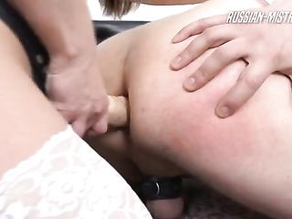 Tiffany strapon fucks her slave in the ass and mouth