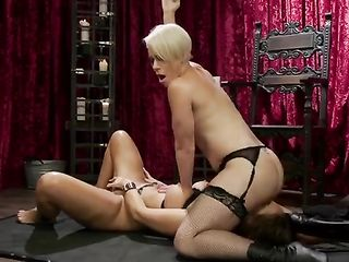 Mistress fucks a girl in handcuffs with a strap-on and sits on her face