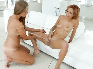 Girl with short red hair blows a powerful squirt