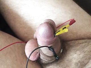 Wire-bound dick spews sperm