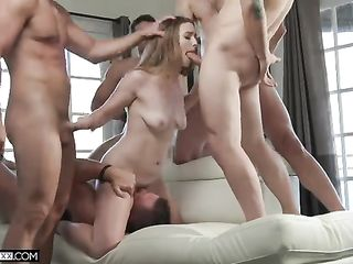 During cunnilingus, a girl gives a blowjob to four guys