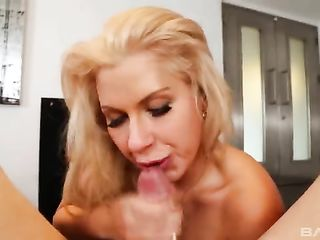 The blonde caresses dick with chubby lips