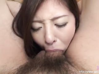 Clamped the girl's head between her legs and makes her suck dick