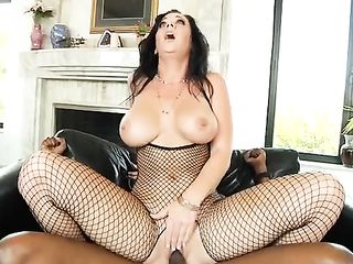 Woman in net suit gets fucked by the hot lover