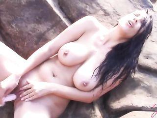 Jelena Jensen masturbates with silicone dick on the beach