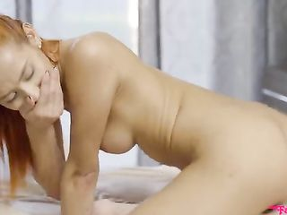 The young girl with red hair has sex with young guy