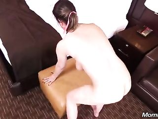 Saggy titted MILF having fun with a young lover in hotel room