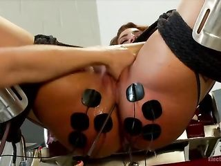 The woman in the wires ends with a squirt from anal stimulation