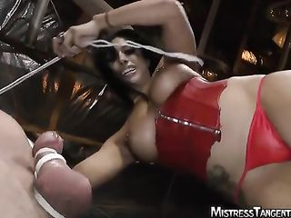 Mistress in a red corset tied dick with rope