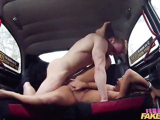 Couple having sex in the backseat of a car