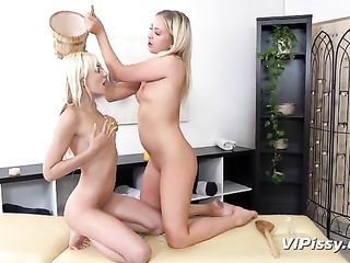 Two blondes pee in a barrel and get drenched
