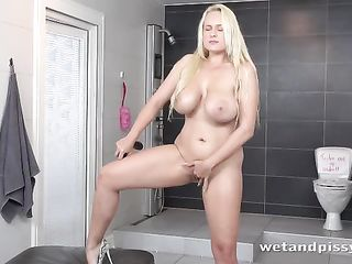 Blonde with natural tits caressed herself and pisses on the floor