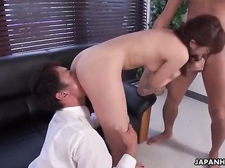 Two students caress young girl