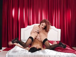 Molly Stewart passionately caresses and kisses brunette in stockings
