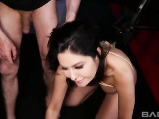 Rope-wrapped brunette gets spanked and fucked