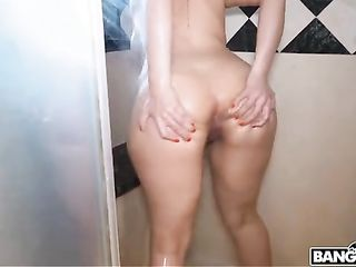 The dude shoots on the phone as a gorgeous woman masturbates in the shower