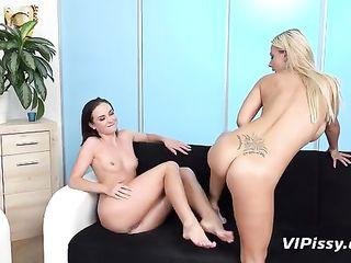 Blonde pissing on the girl's legs