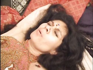 Woman with intimate haircut shows pussy in cum after oriental sex