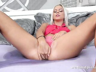 Blonde in panties pees on the bed