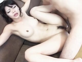 Fucking a young Japanese woman with a hairy pubis