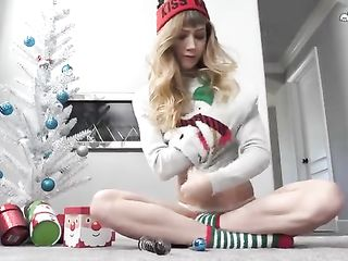 Ivy Wolfe masturbates with Christmas presents under a small, ornate Christmas tree