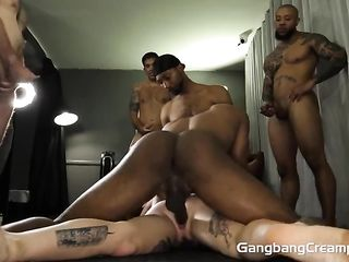 Mulattoes fuck a curly brunette with tattoo hard