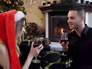 Beautiful young couple having sex by the fireplace on Christmas Day