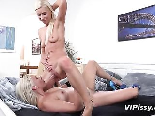 One blonde pees in the mouth of another