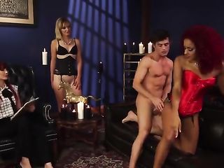 Beautiful ladies caress a man's dick with their legs and fuck him
