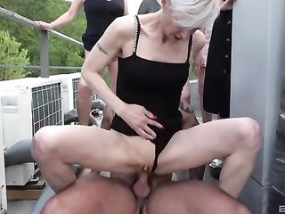 Five old ladies fuck a construction worker on the roof
