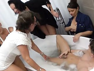 Old women giving a blowjob to a guy in the bathtub