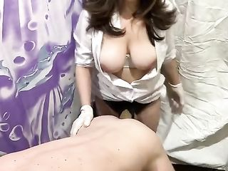 An experienced nurse inserts a thick strapon