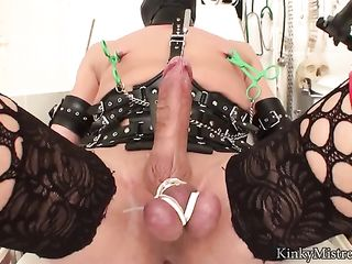 Dominatrix femdom sounding with black latex gloves