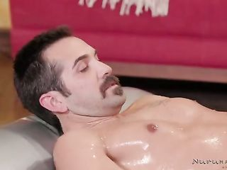 Bridgette B massages her lover with oil before sex